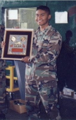 Sempere holding his awards